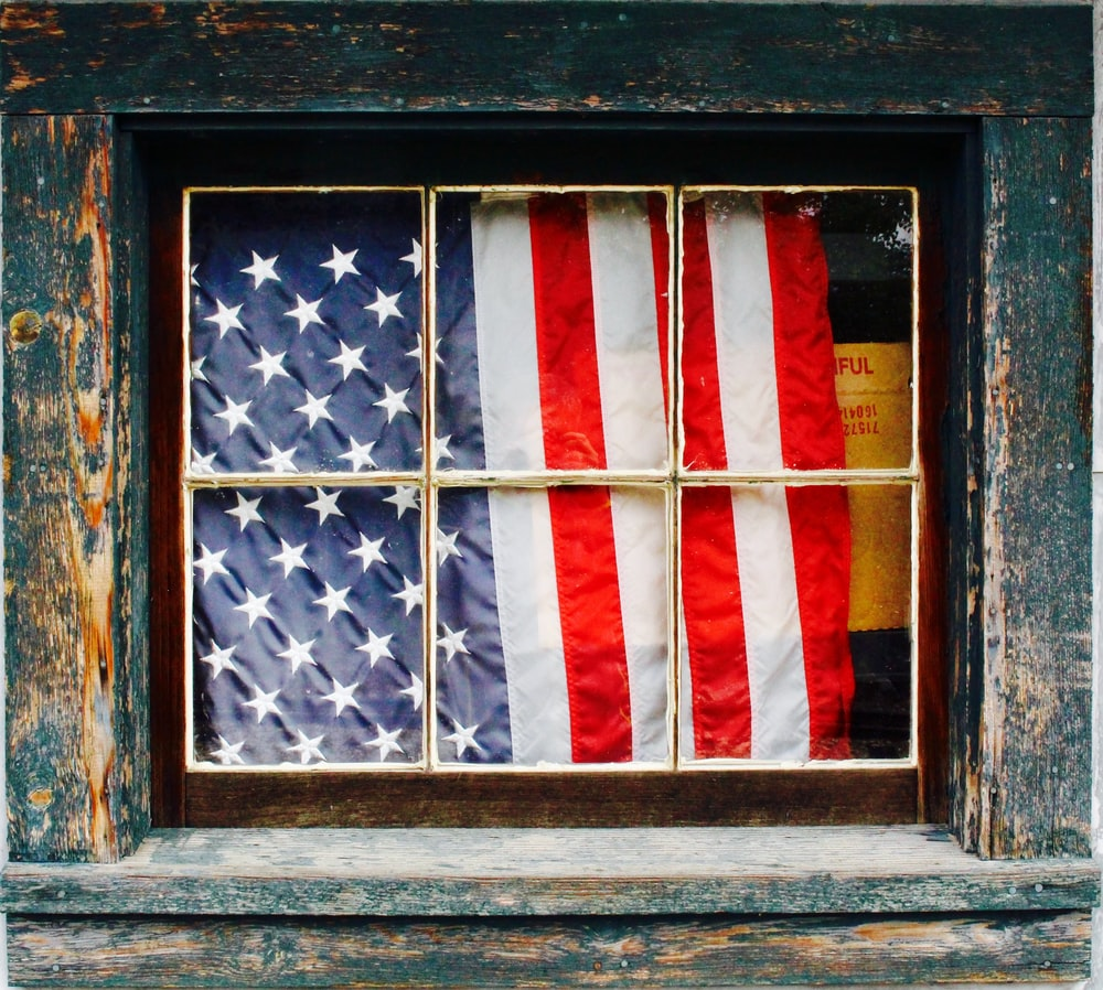 United States of America flag on window pane