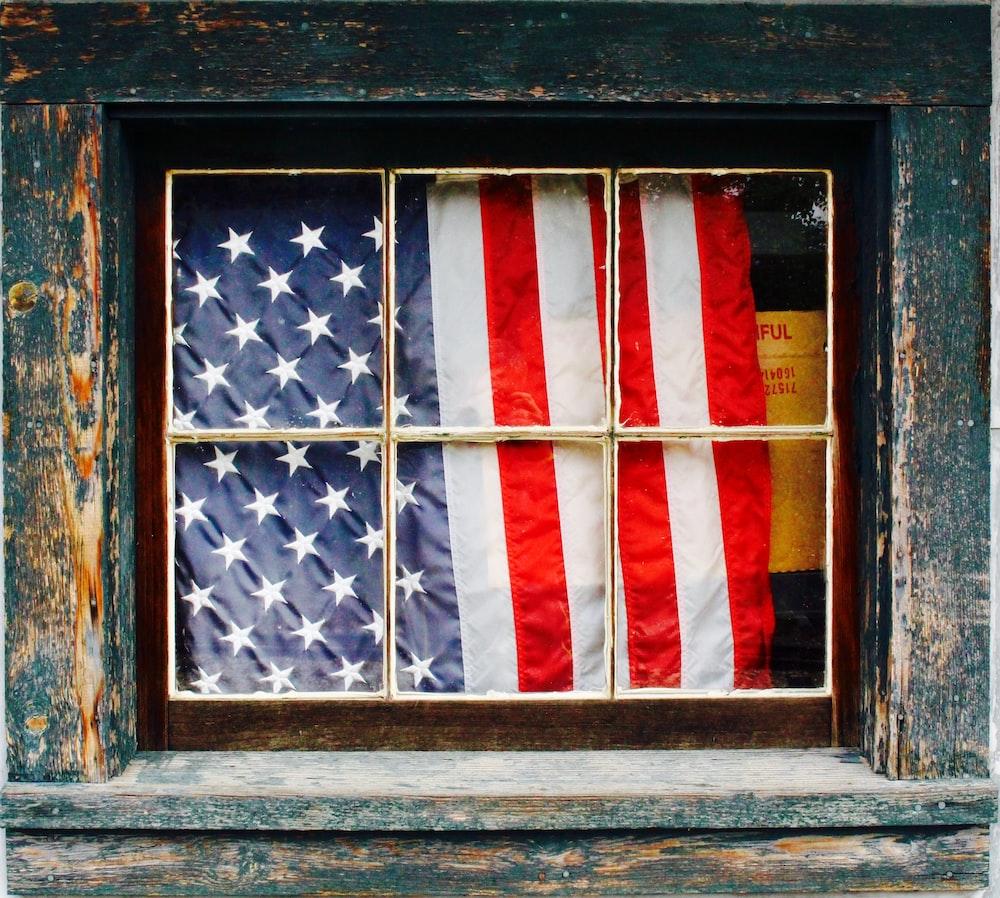 United States of America flag on window pane