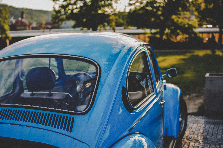 bokeh shot of blue Volkswagen Beetle