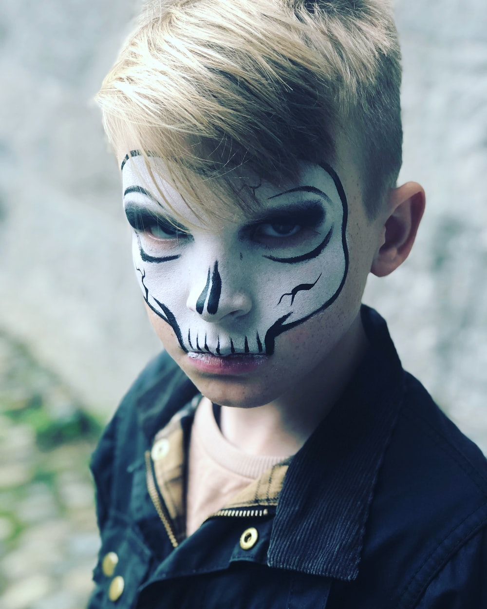 child with skull face painting