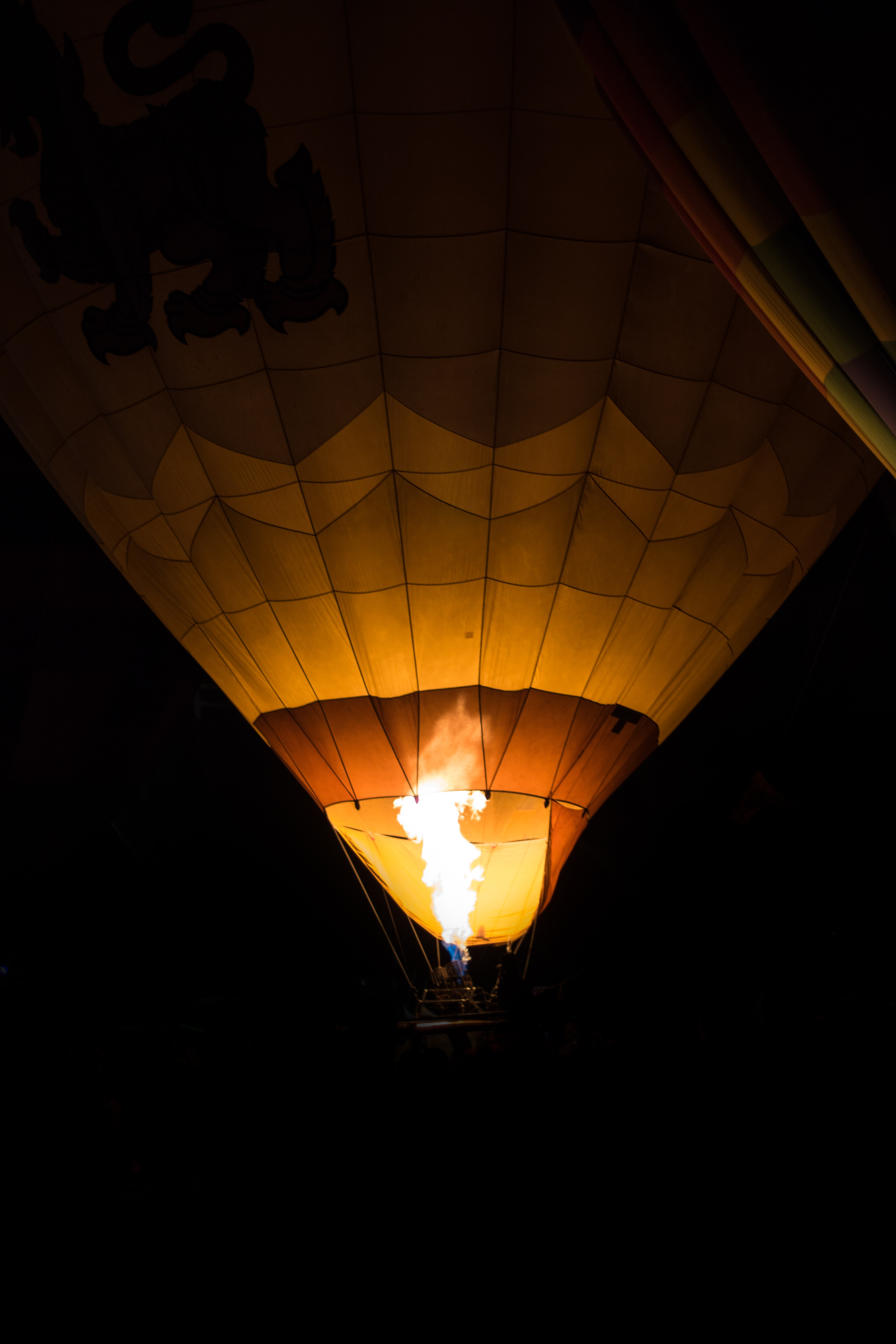lighted hot air balloon during night time