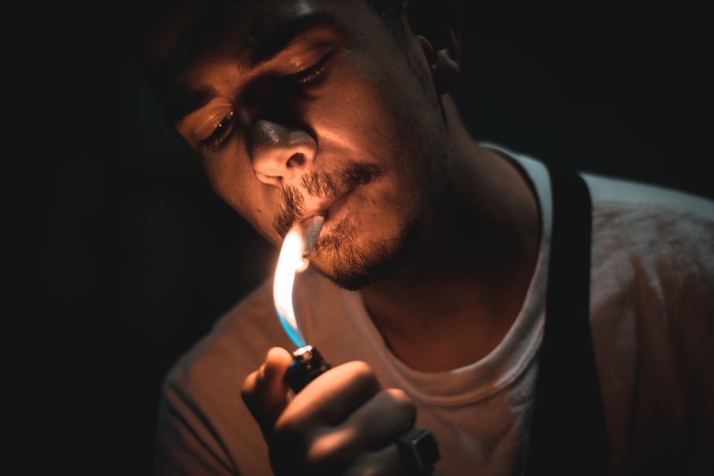 man lighting cigarette