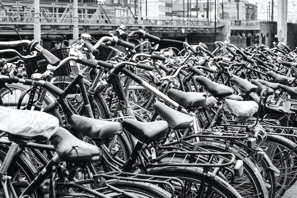 greyscale photography of bicycle display