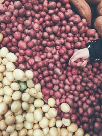 person holding red potatoes