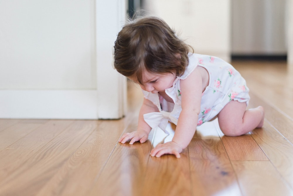 girl crawling on parque floor