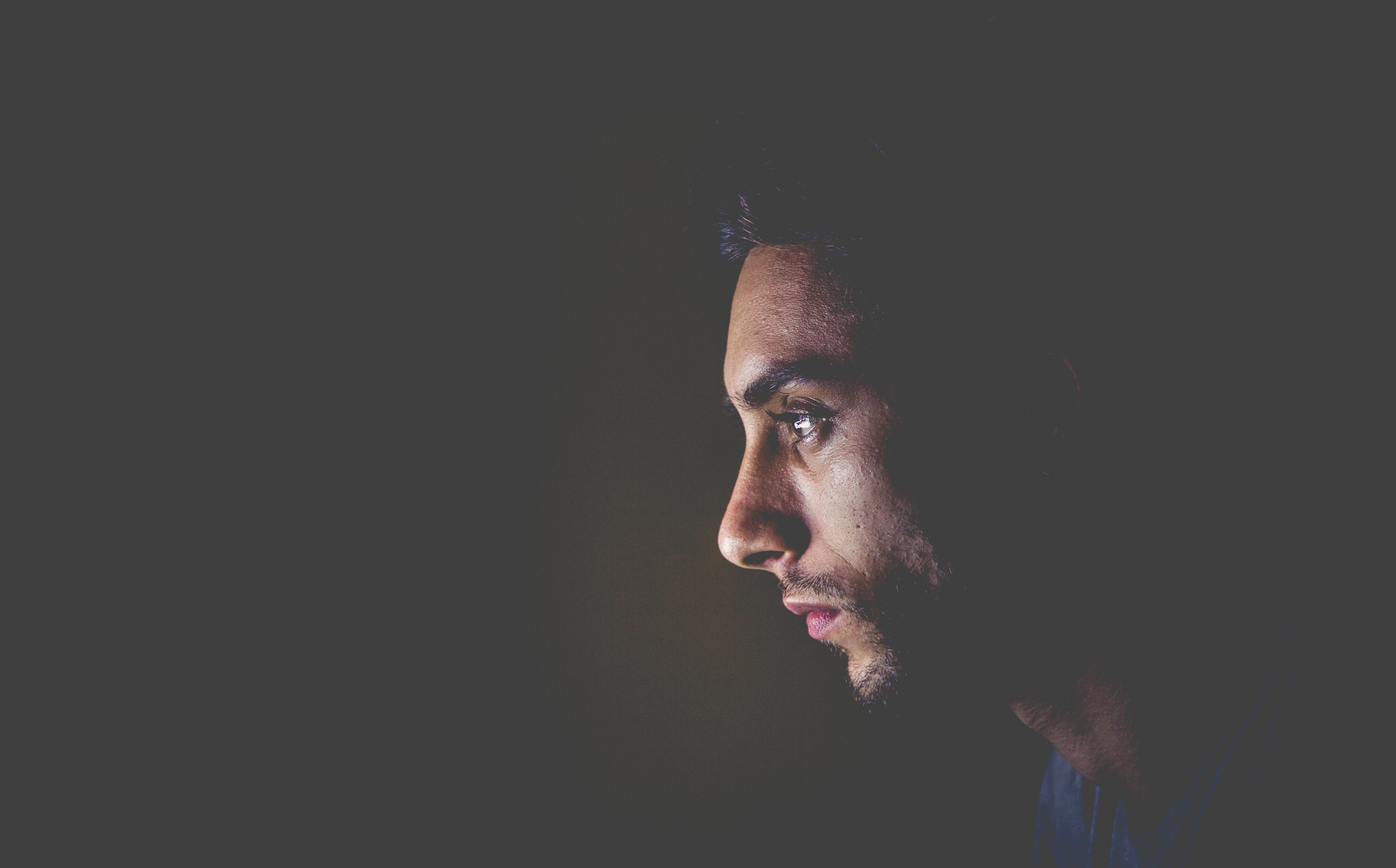 selective focus photo of man face