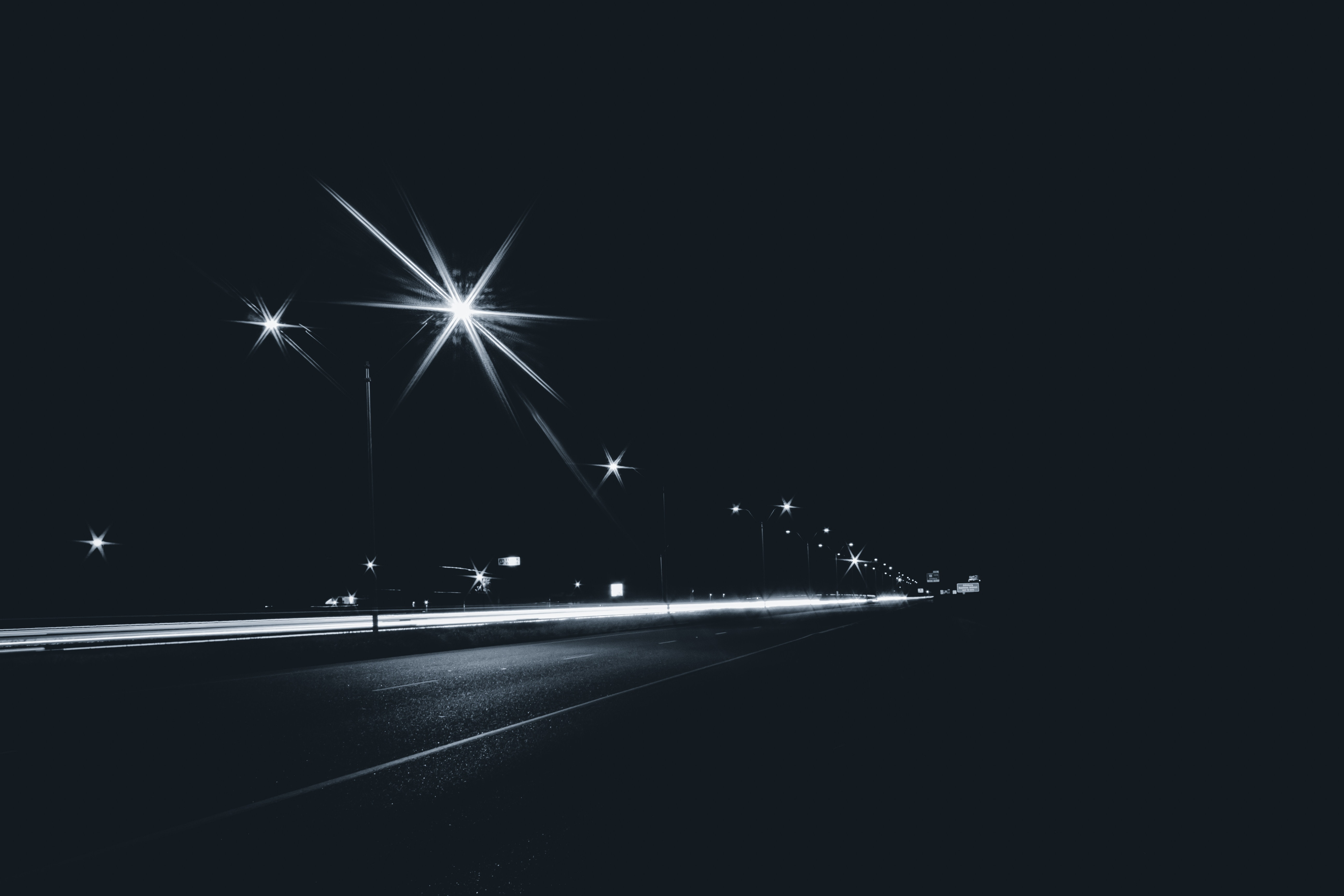 grayscale photography of street lights
