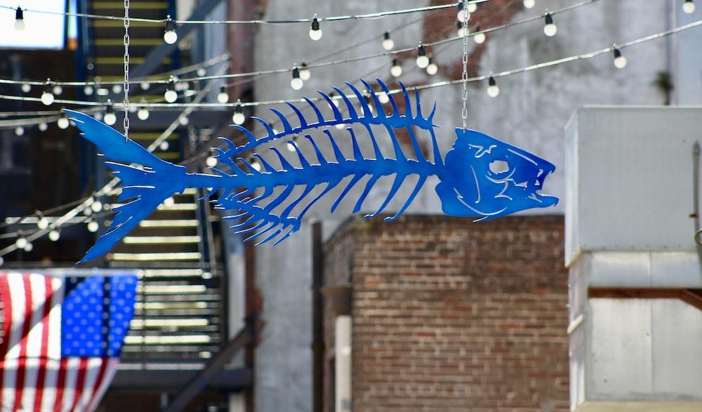 blue plastic fish toy hand