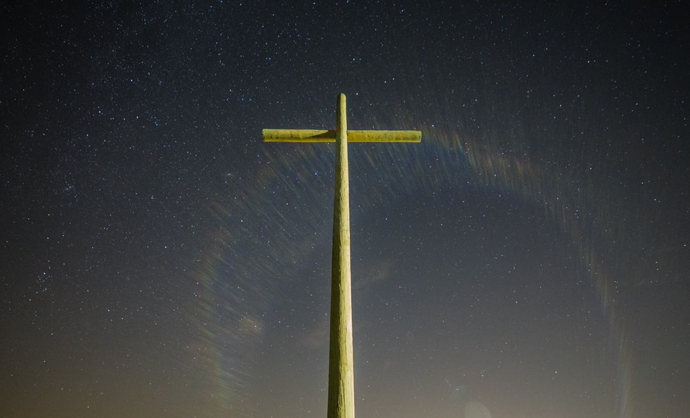 gray cross statue during nighttime
