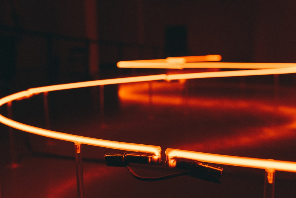 shallow focus photography of red strip lights