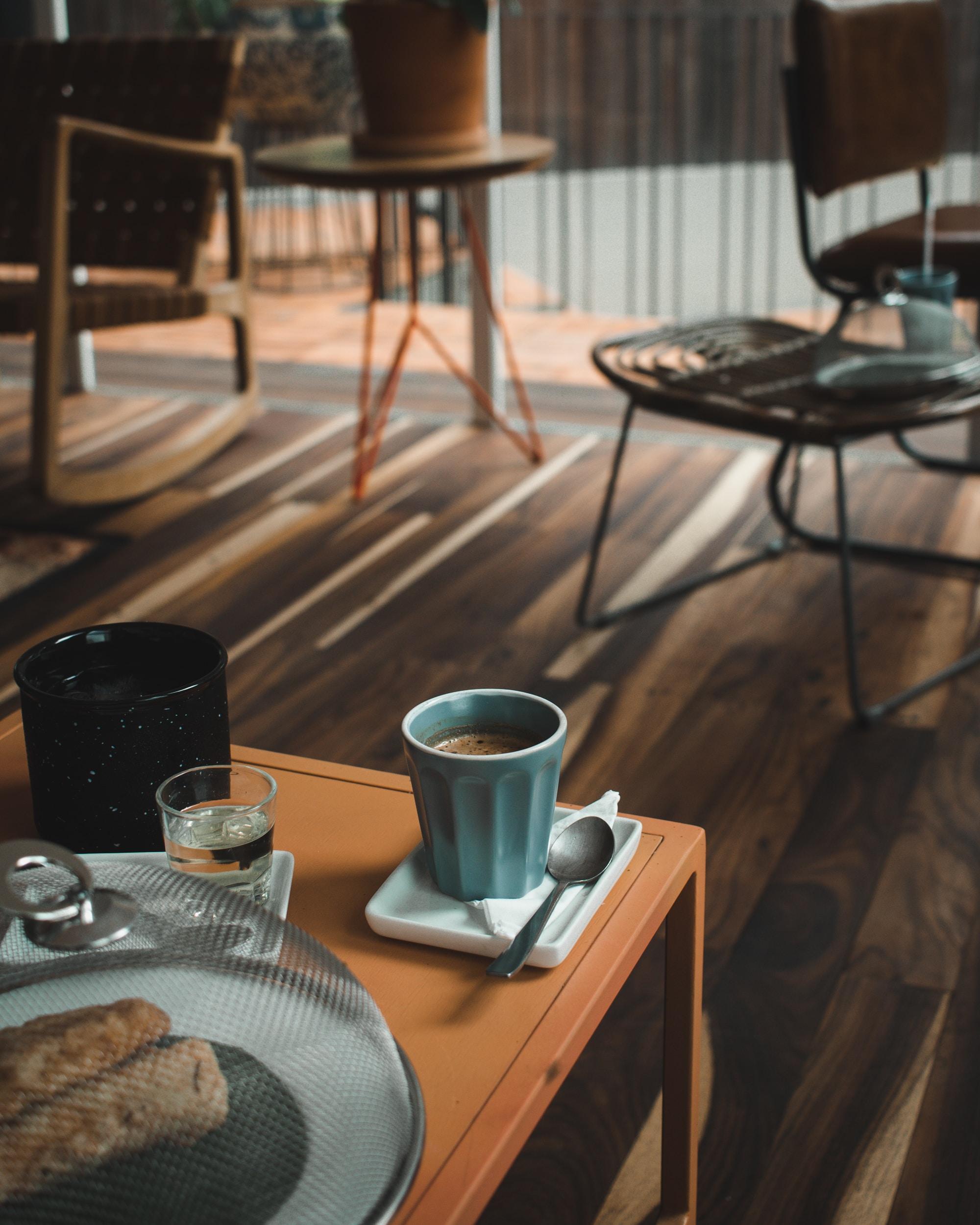 blue ceramic mug on table