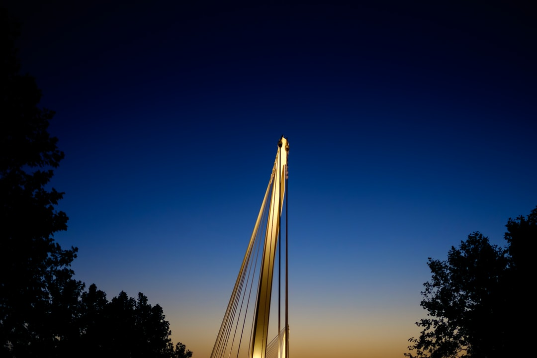 This is an autumn twilight shot of the Passerelle Mimram in Strasbourg. Built in 2004, this impressive footbridge over the Rhine was the symbol of the NATO 2009 Strasbourg–Kehl Summit.