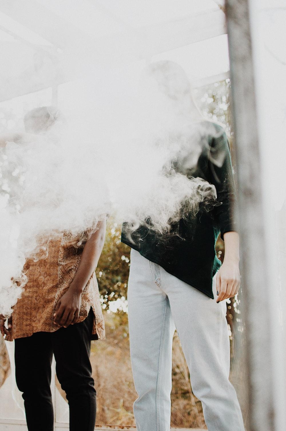 man standing with smoke