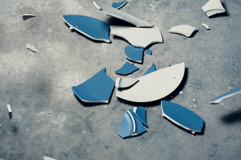 top view photography of broken ceramic plate
