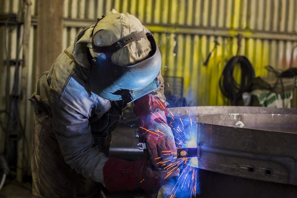 man soldering steel