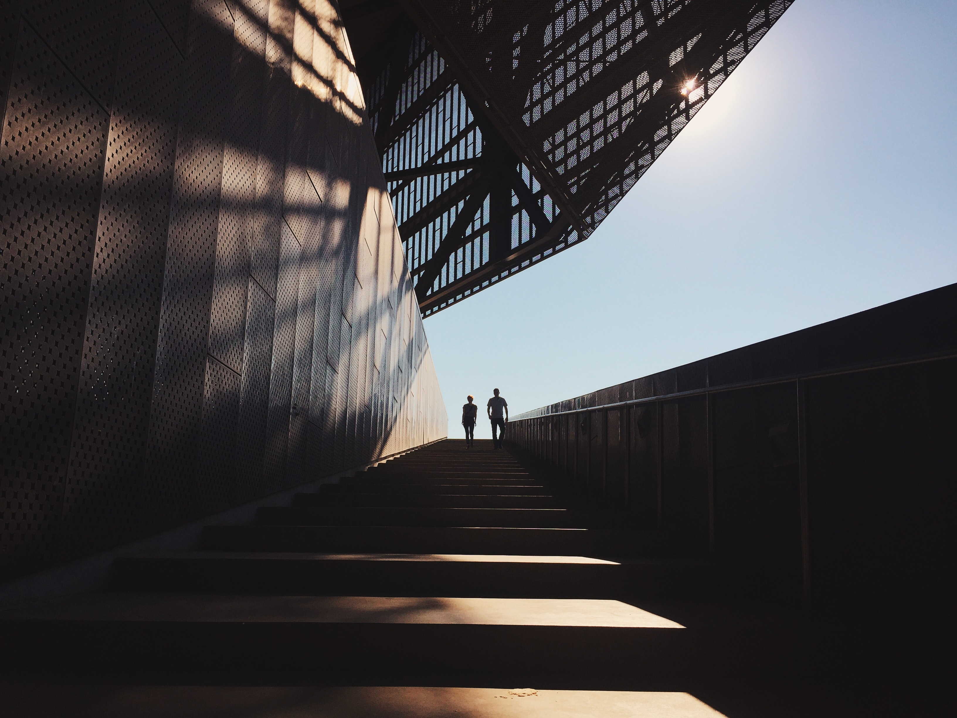 two people standing on staircase