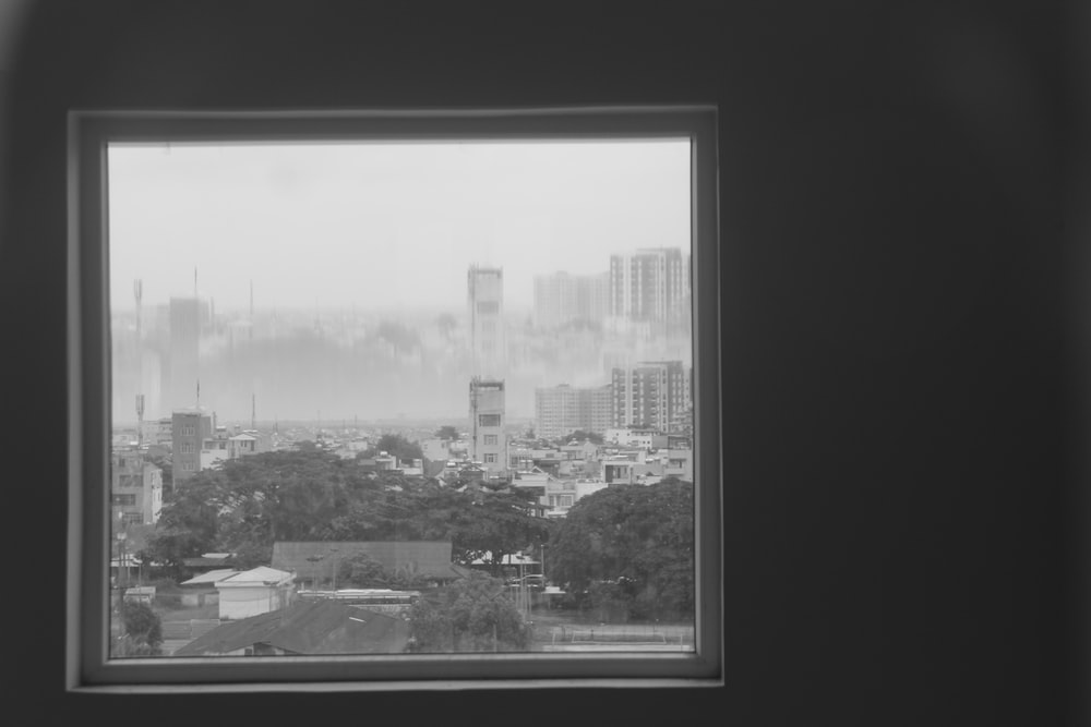 grayscale photography of glass window with fogs