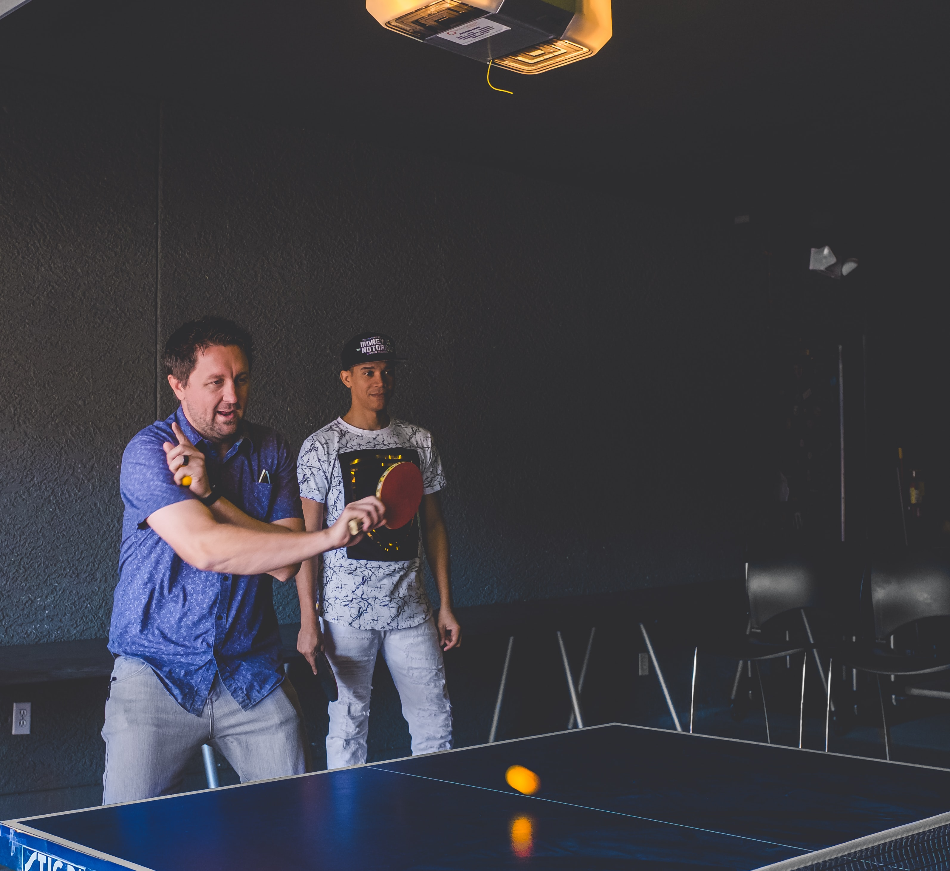 man playing table tennis