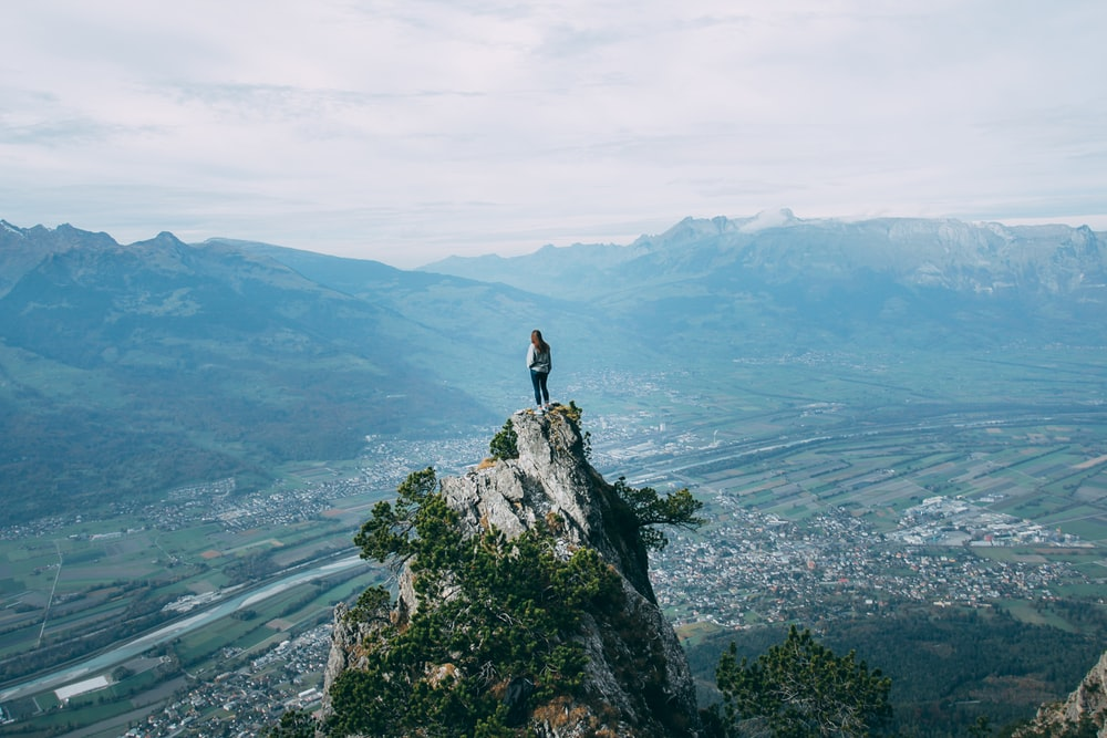 person standing on top of mountain