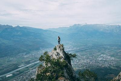 person standing on top of mountain liechtenstein zoom background