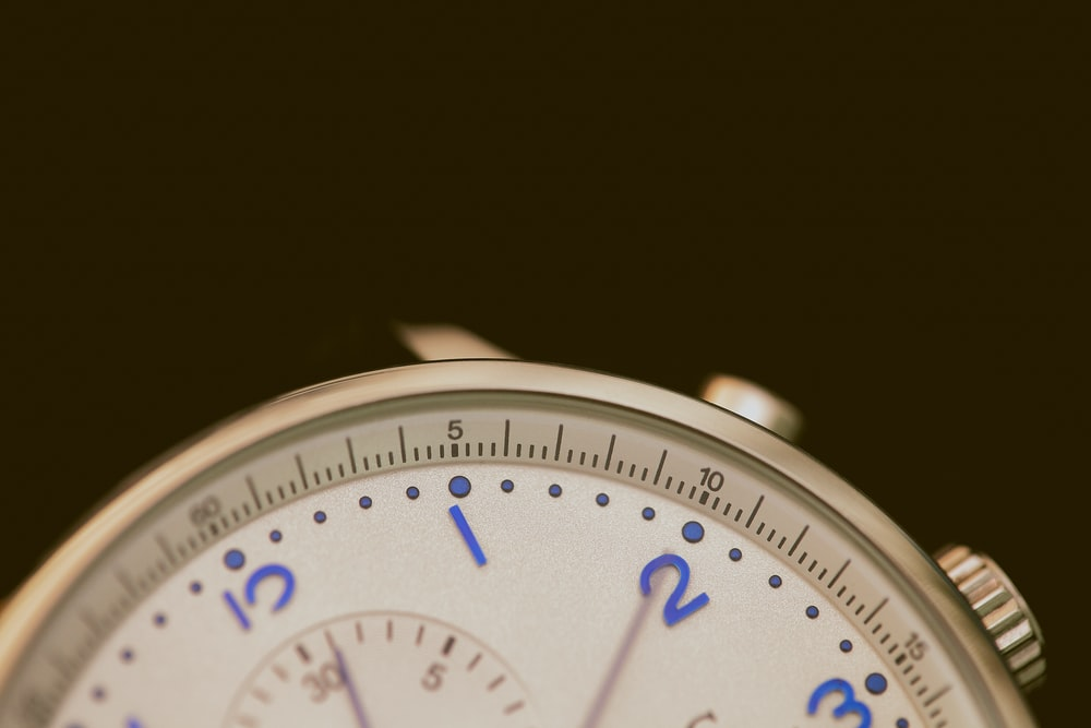 closeup photo of gray chronograph watch