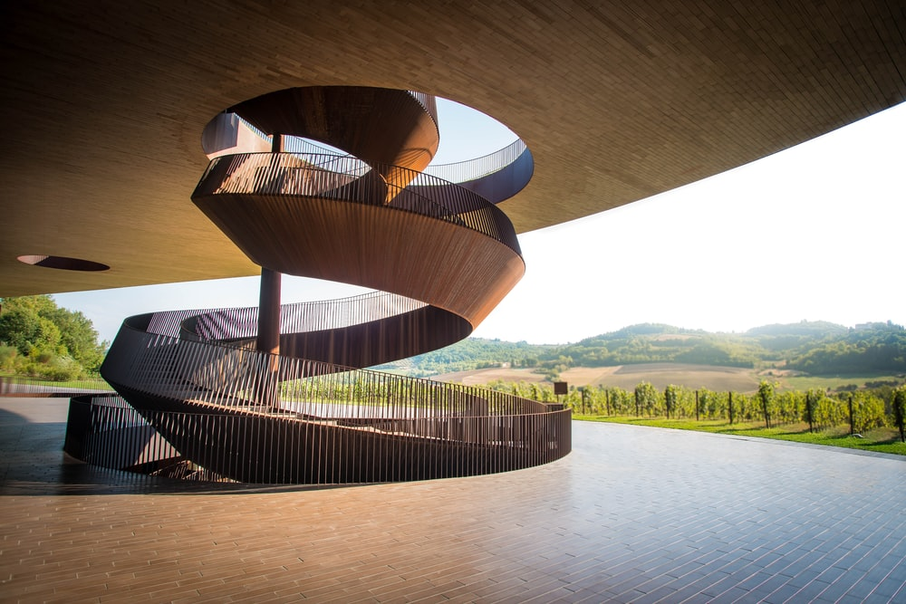 brown spiral staircase near mountains