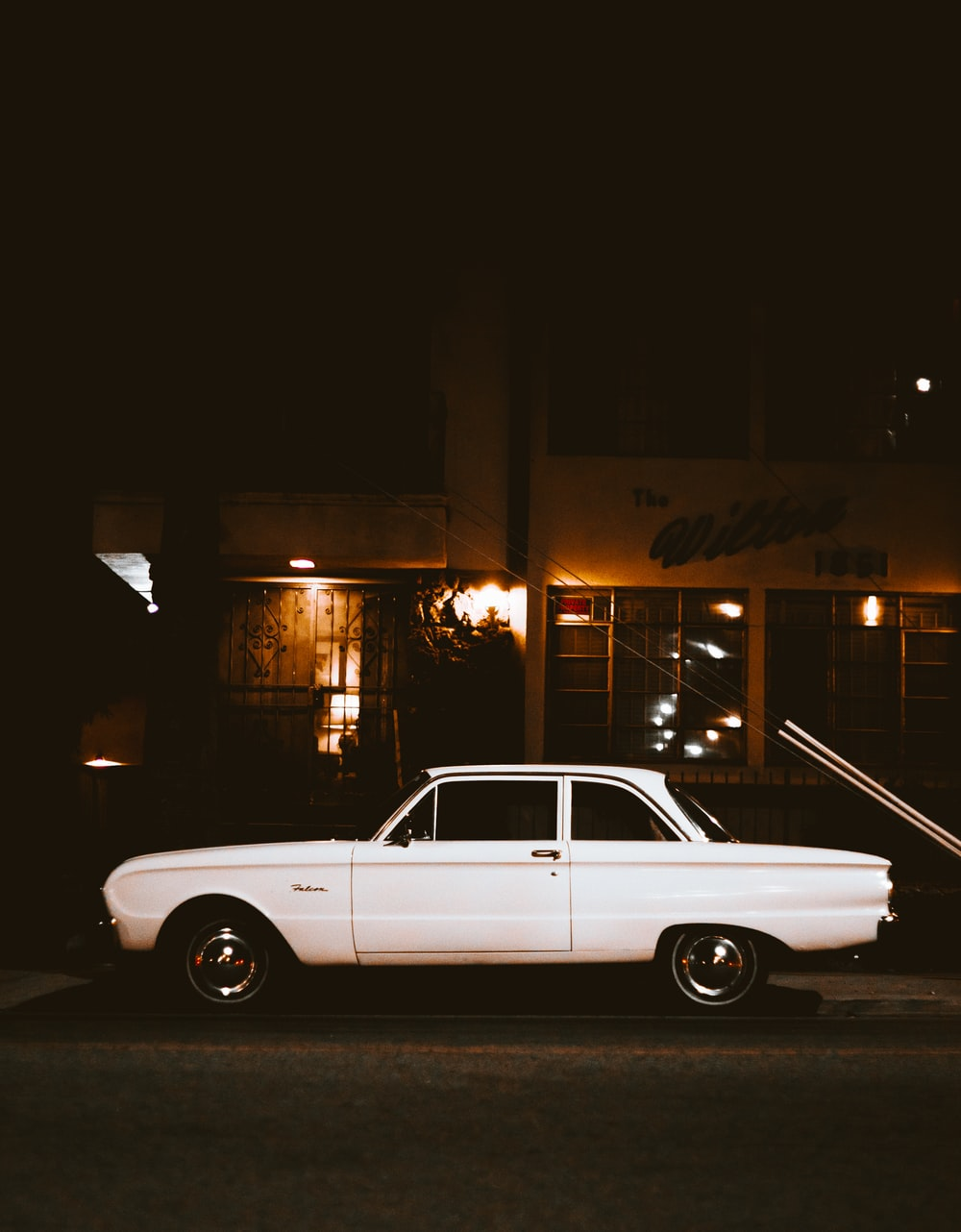 white car parked beside the street