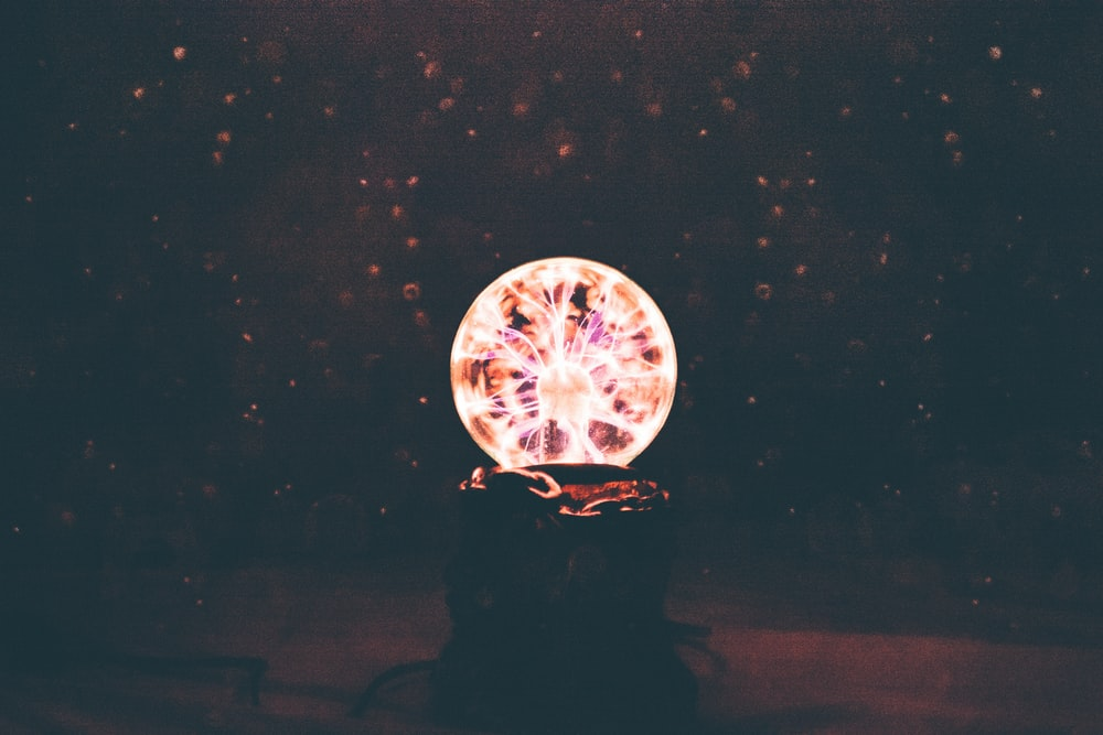 multicolored plasma ball in dim light room