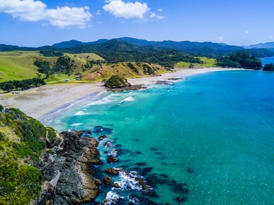 aerial view of beach with mountains new zealand zoom background