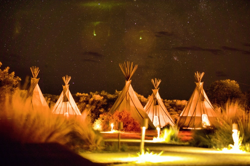 photography of tipi tents