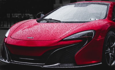 red sports car hood raindrop zoom background