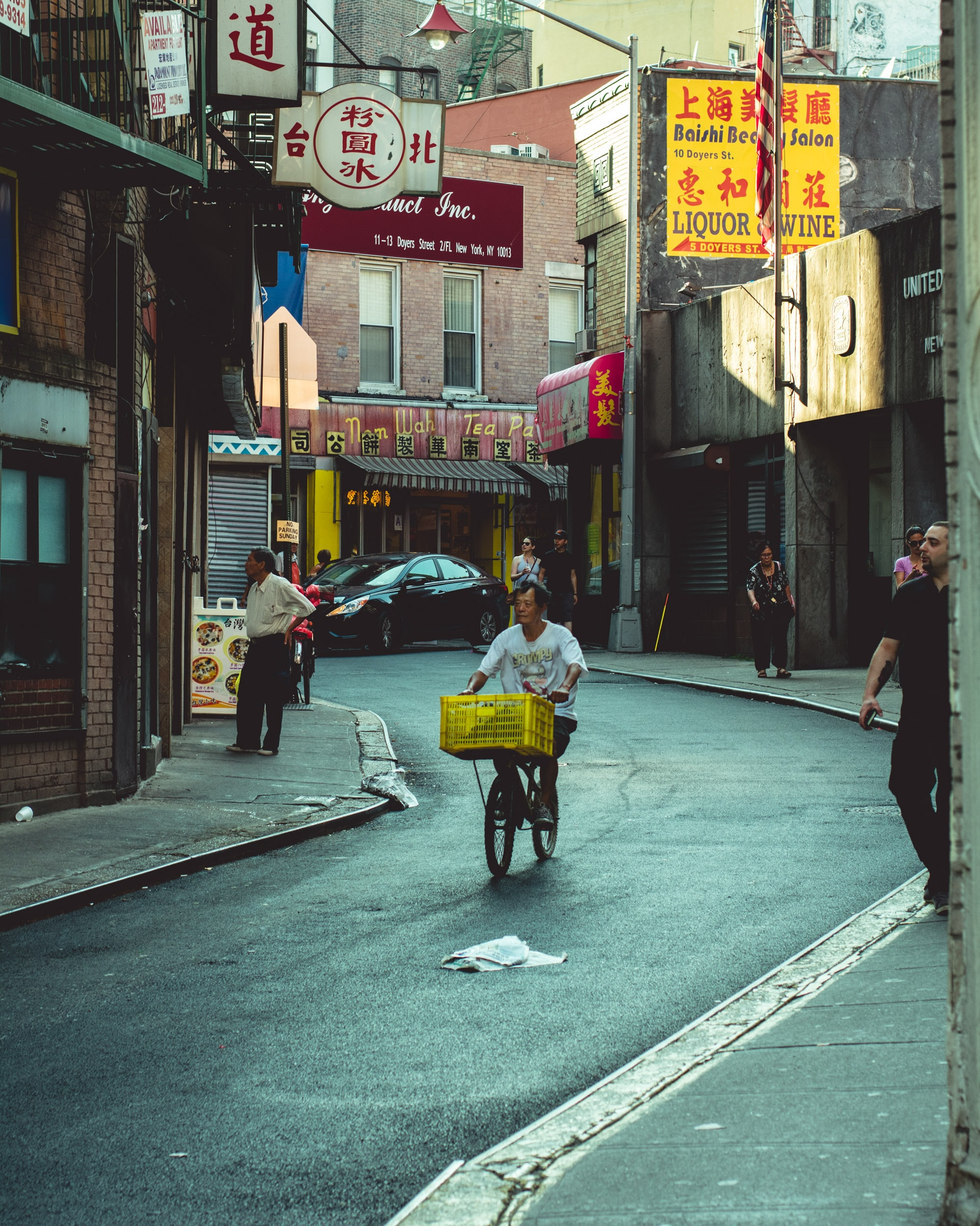 man riding bicycle in an alley
