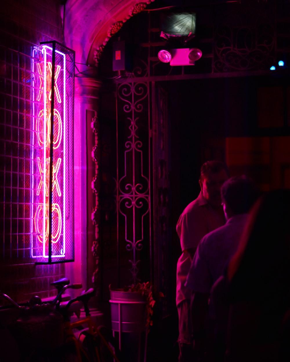 man standing on neon light