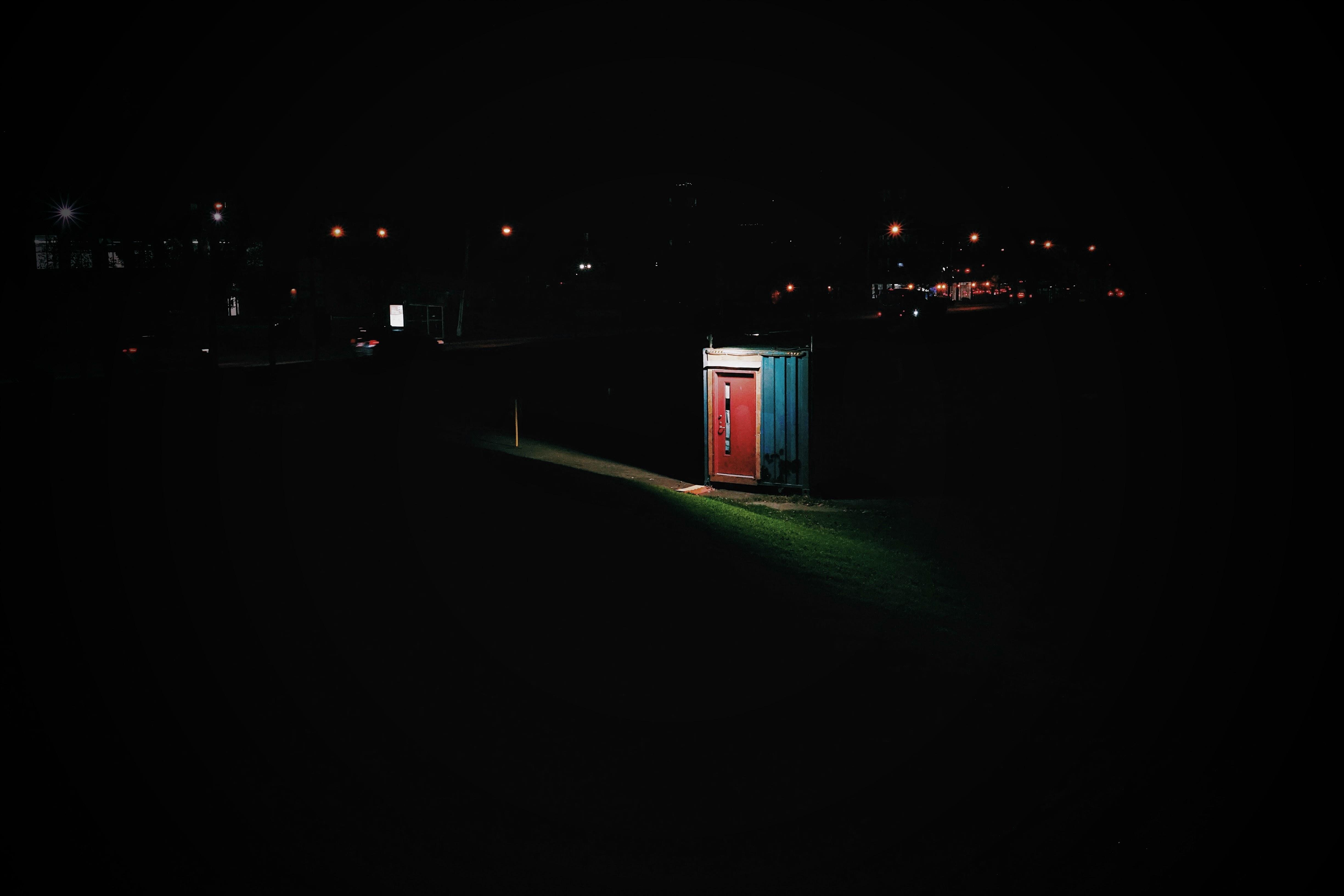 red door shed taken during night time