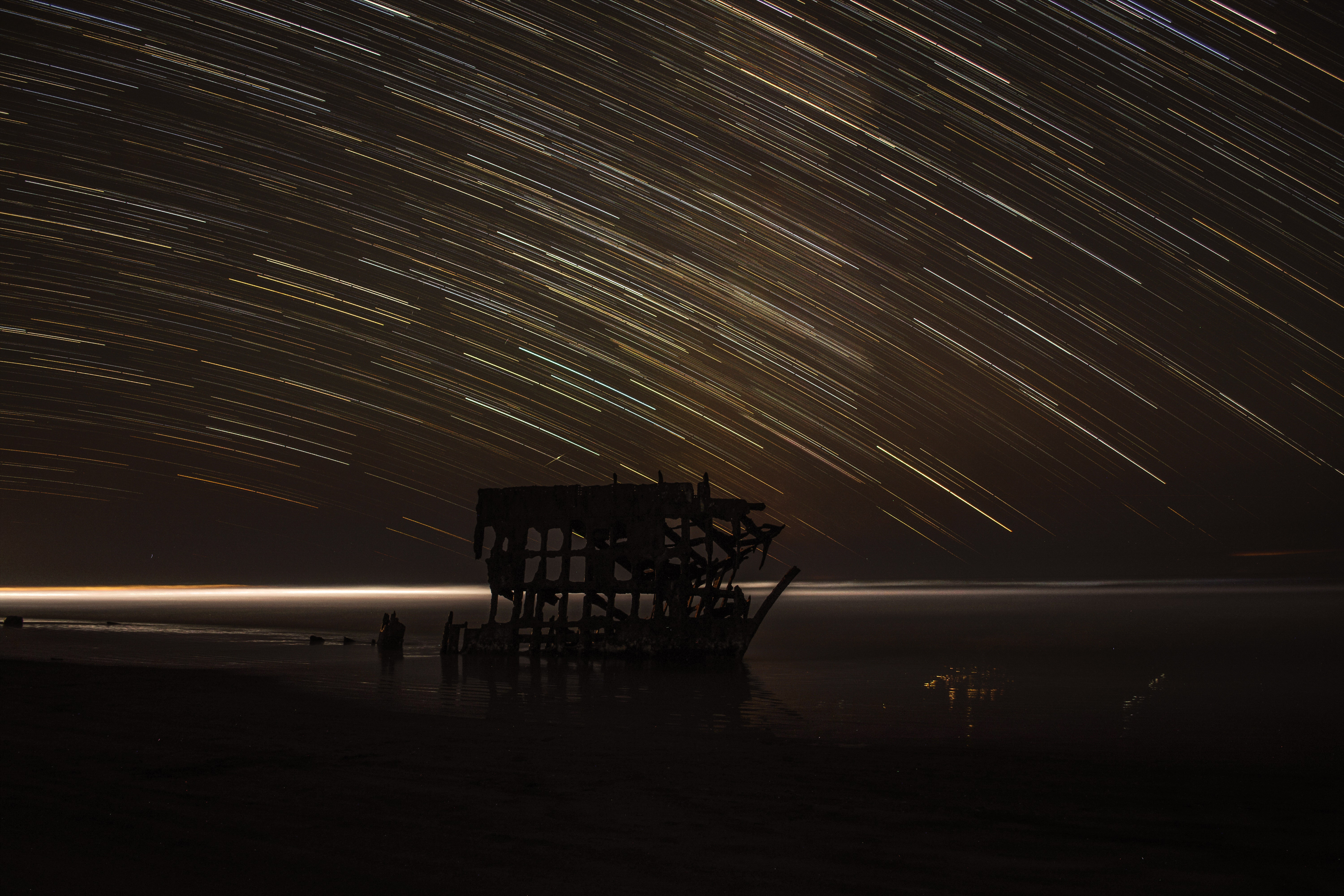 time lapse photography of house with shooting star at night time