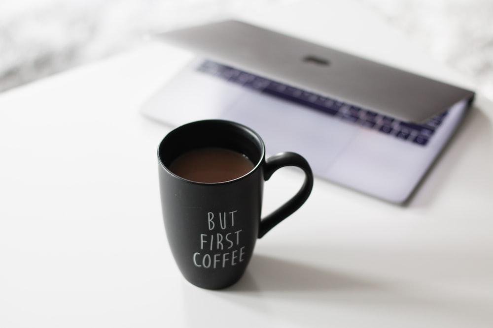 selective focus photo of filled black ceramic mug