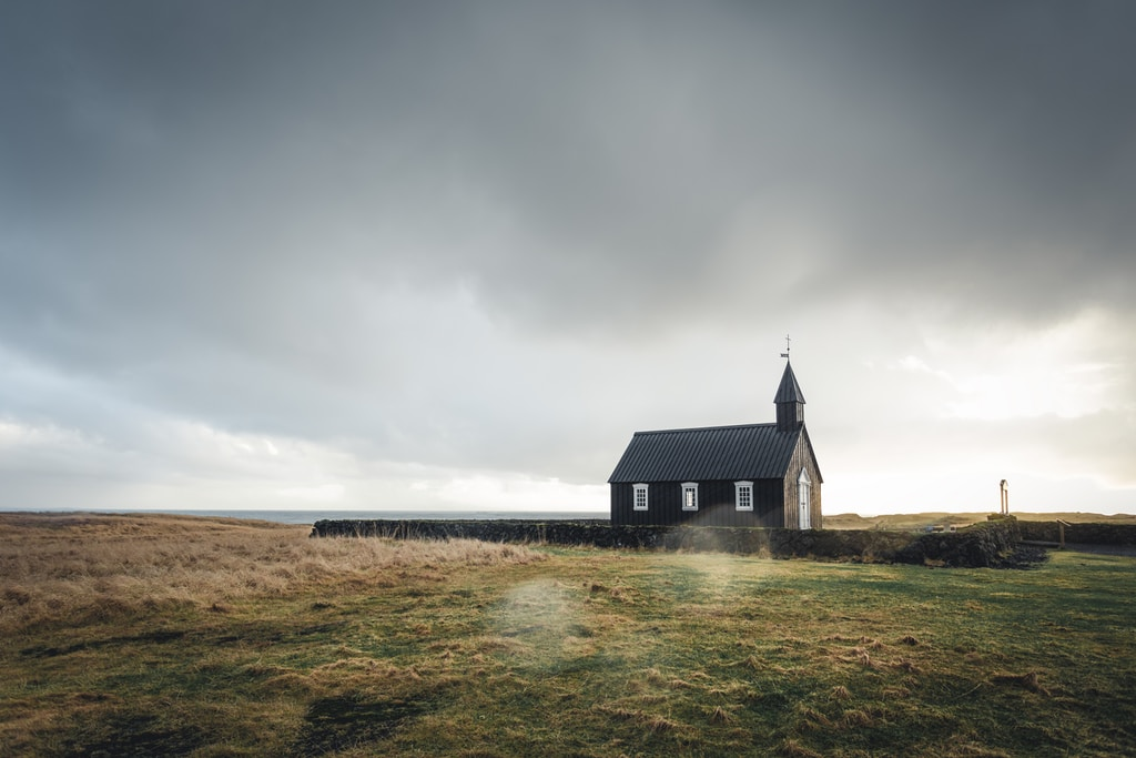 church surrounded by grass