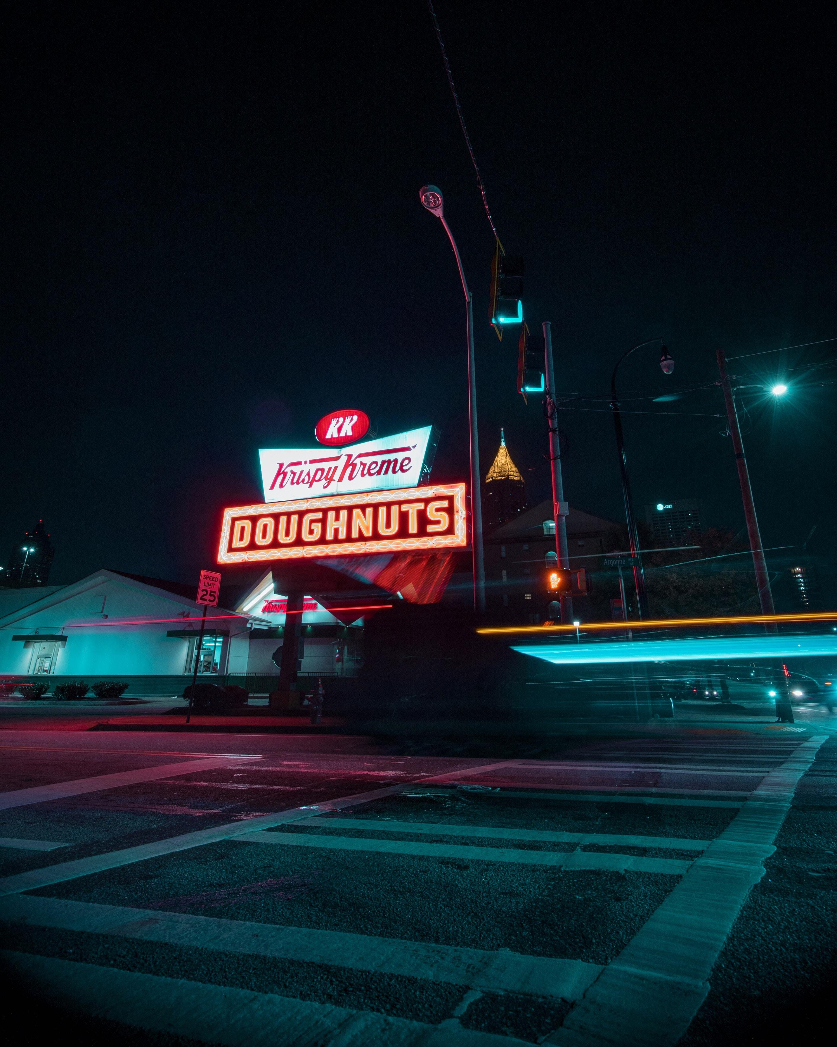 turned on Krispy Kreme Doughnuts neon signage