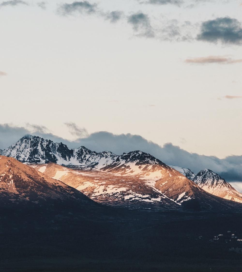 glacier mountain under gray sky at daytime