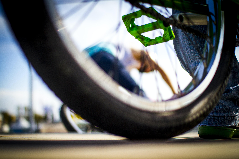 selective focus photo of bicycle wheel