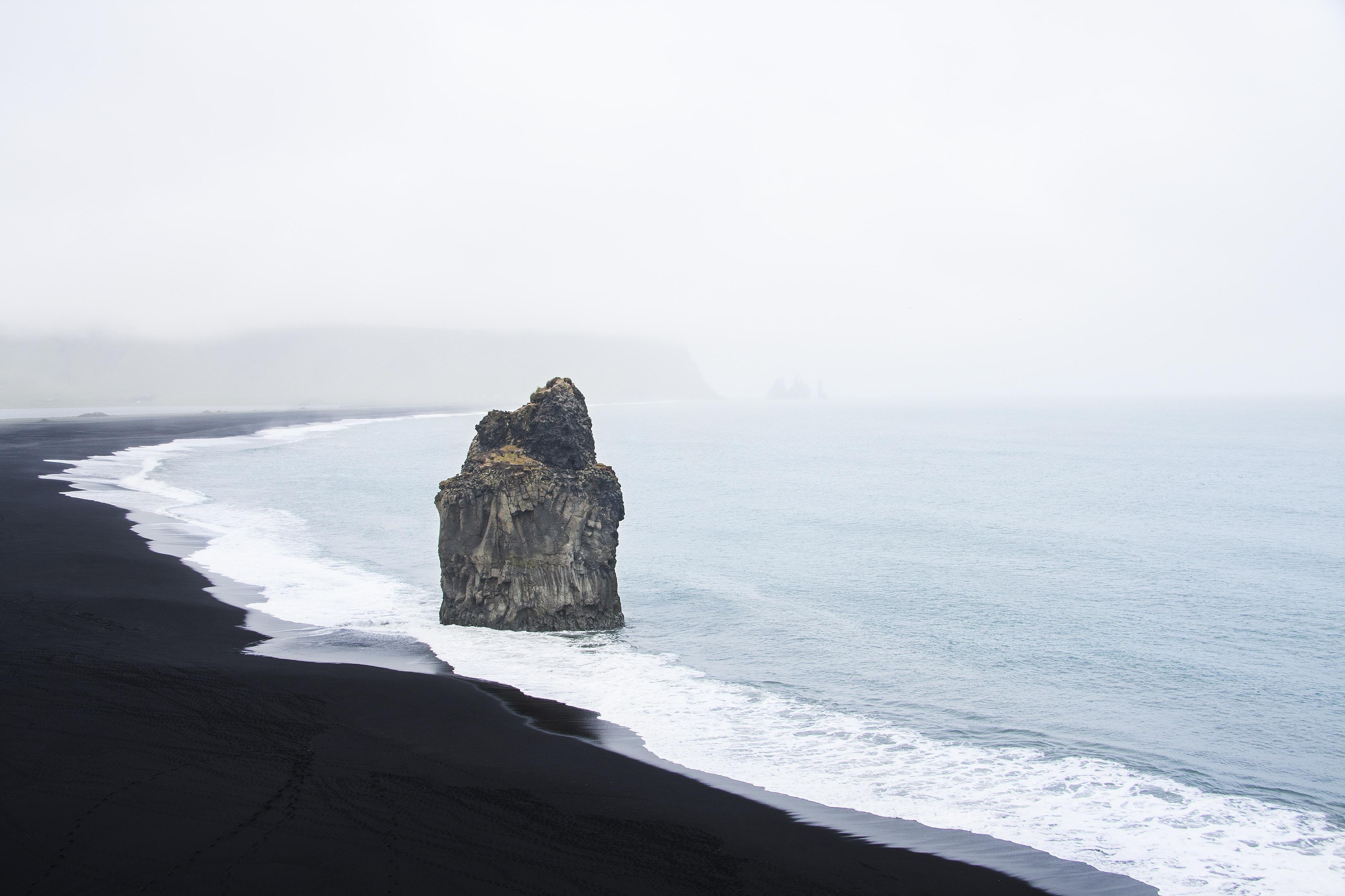 brown stone on seashore