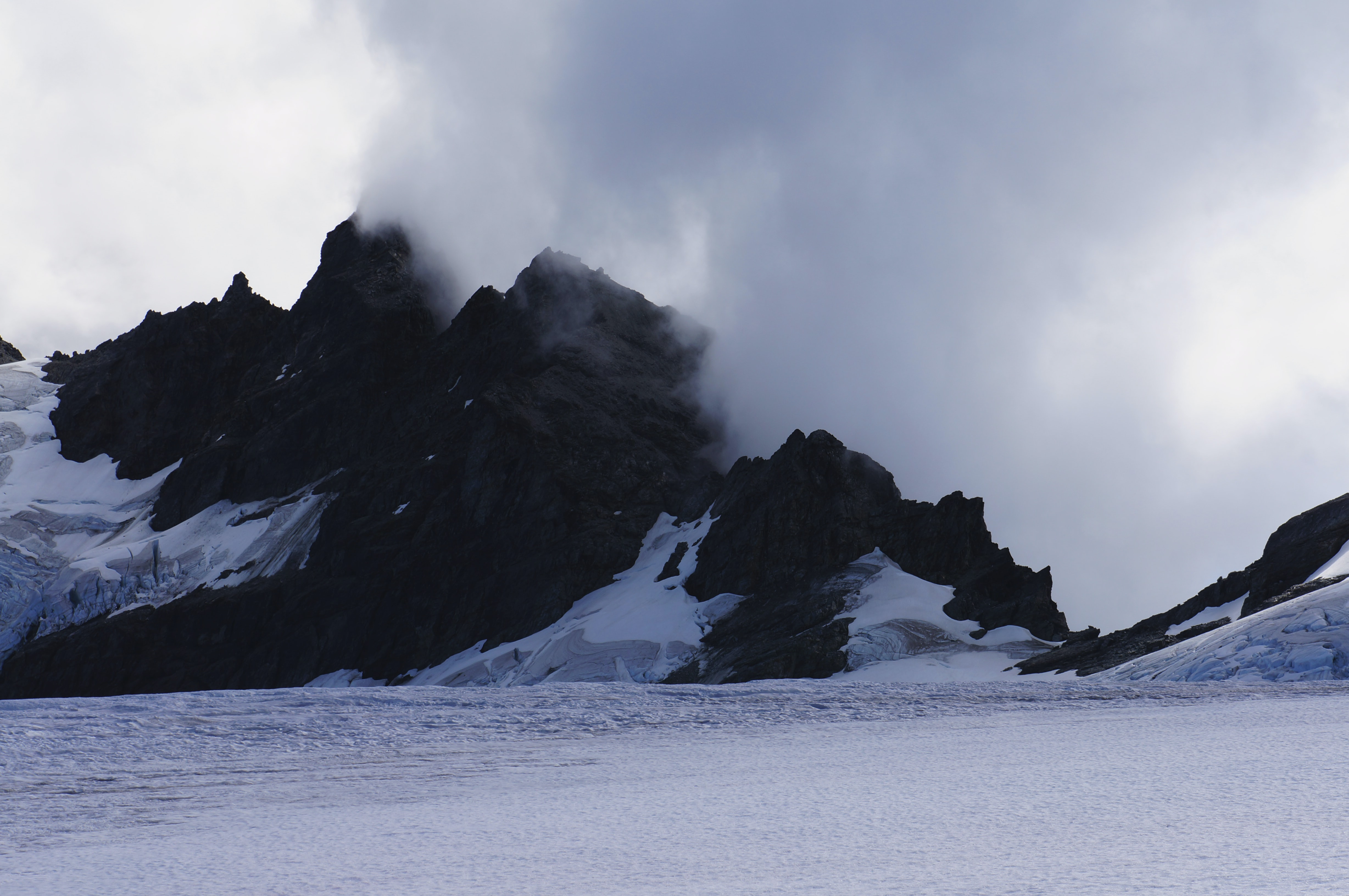 snowy mountain covered with fog