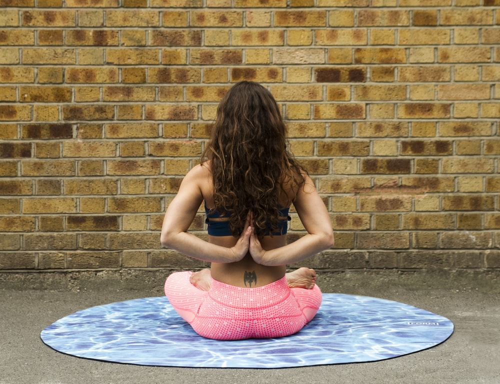 woman meditating on floor