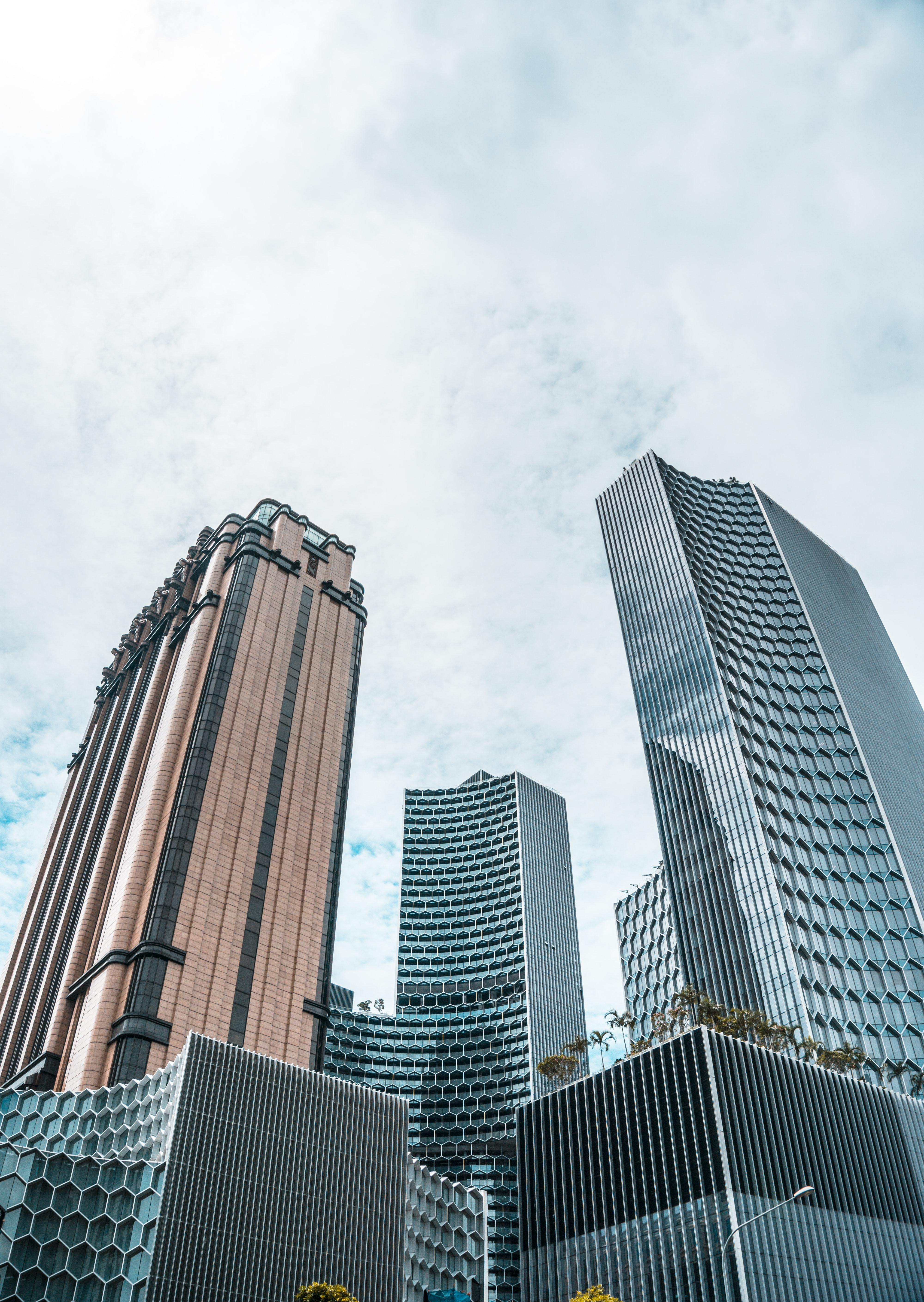 low angle photo of curtain wall buildings at daytime
