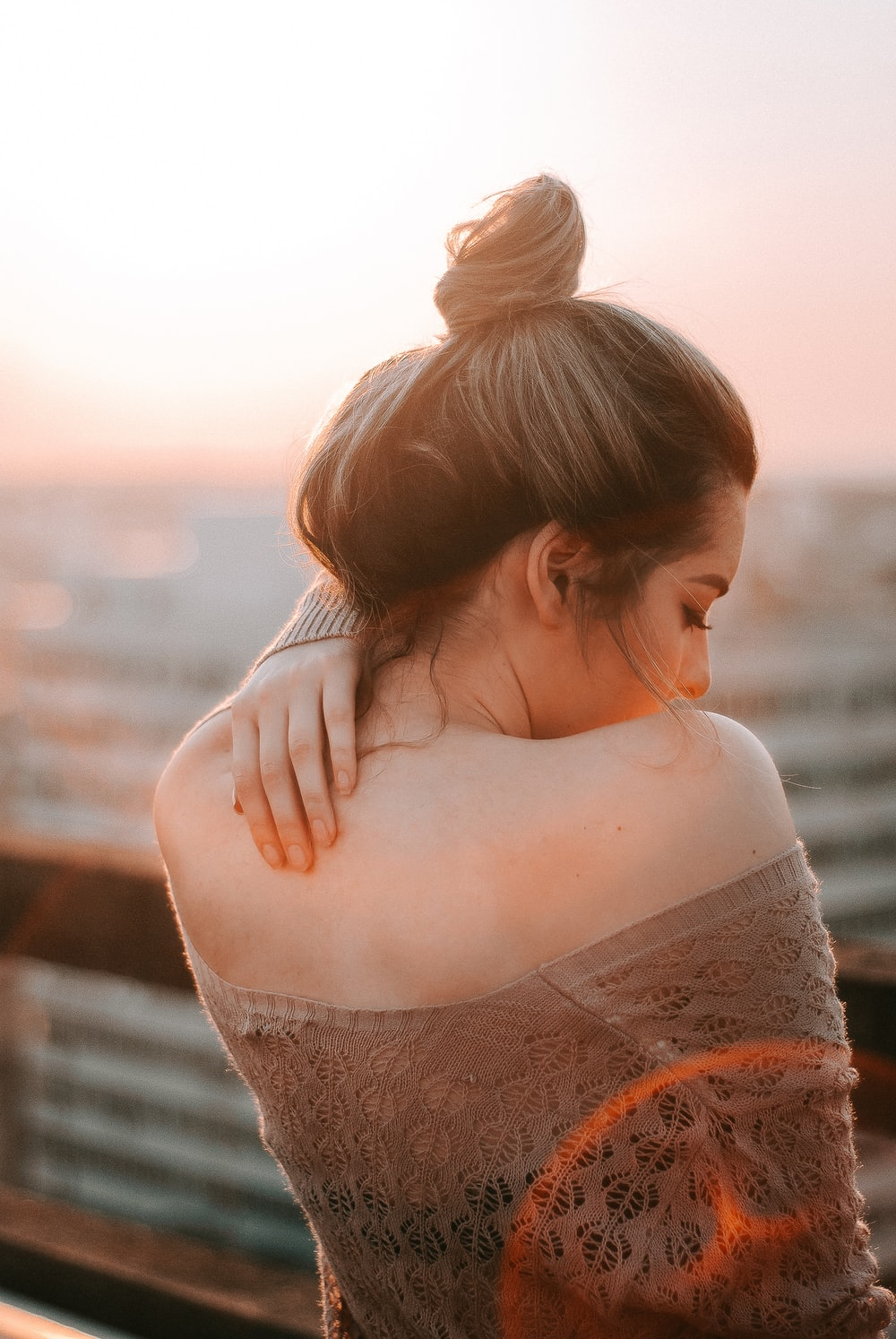 woman in beige lace top