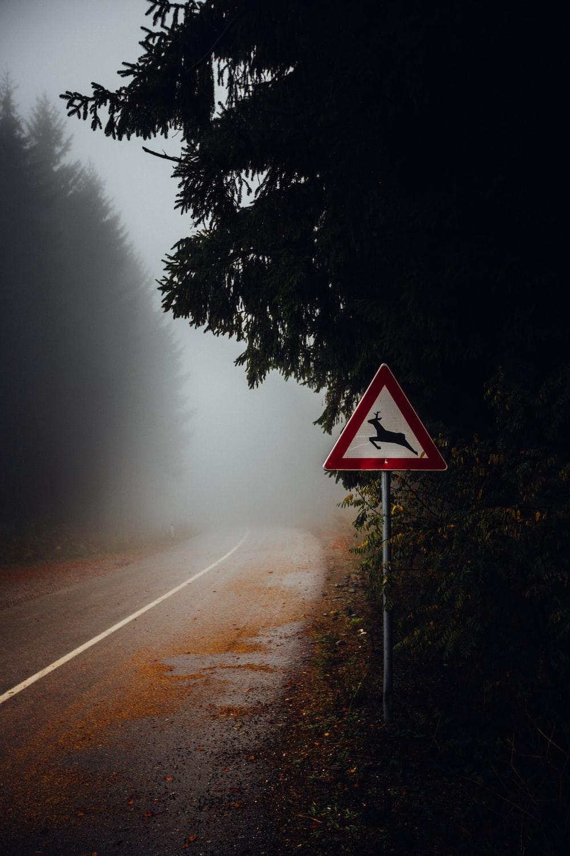 road sign on side of asphalt road
