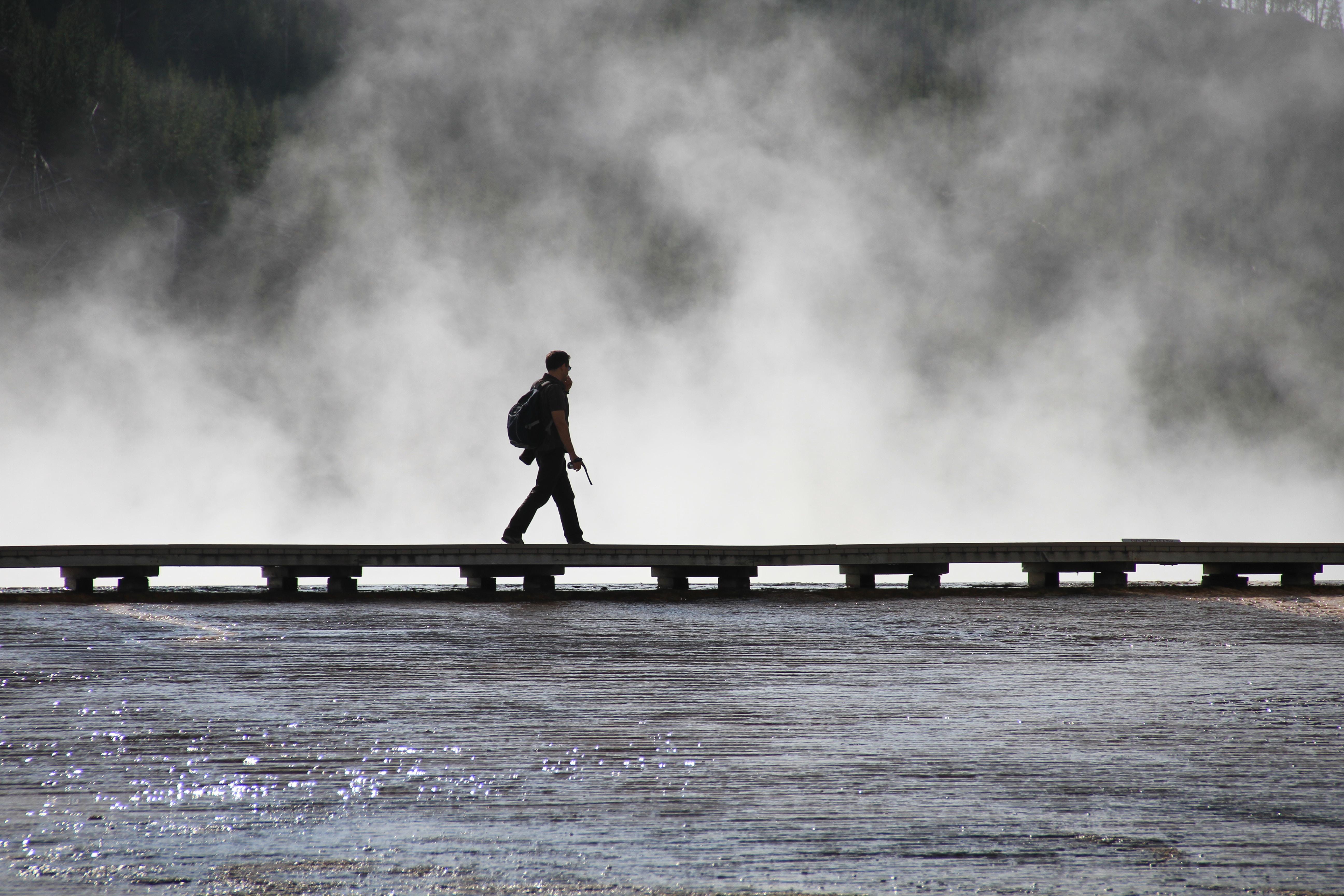 person walking on wooden dock