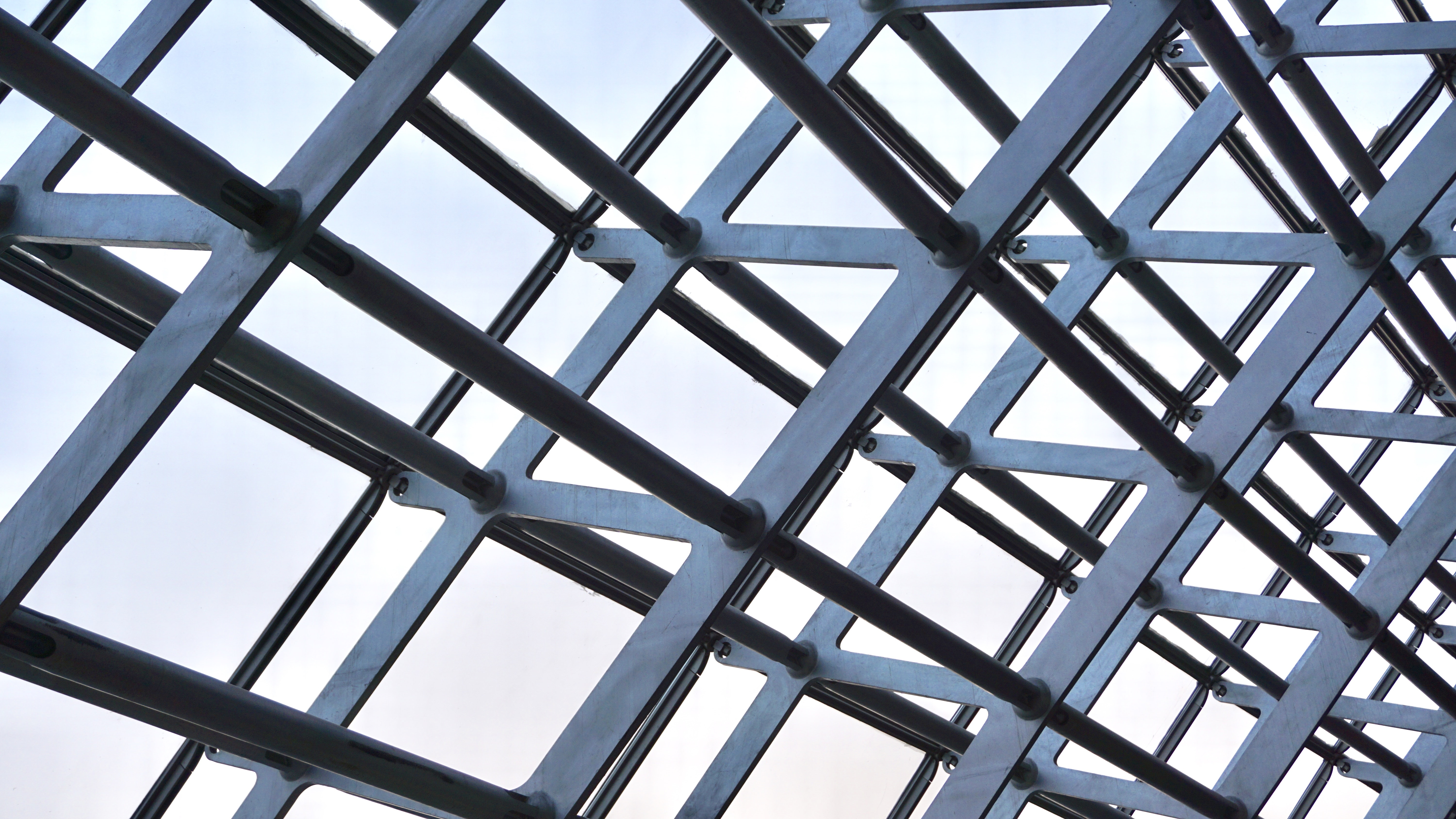 photo of gray metal structure during daytime