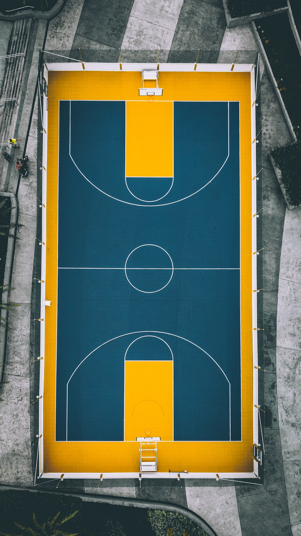 aerial view photography of yellow and blue basketball court