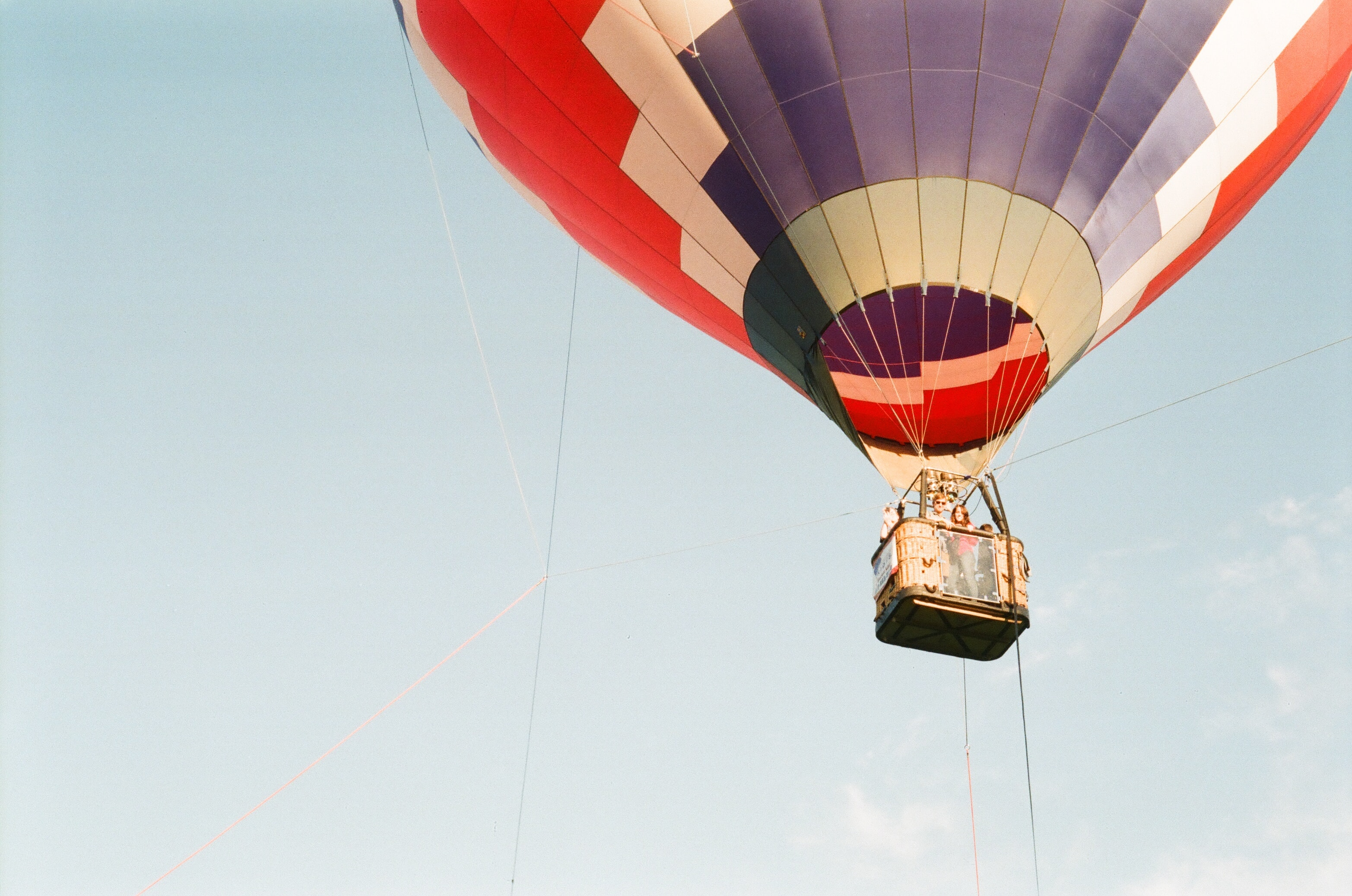 photo of hot air balloon taking flight under clear blue sky